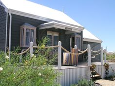 charcoal weatherboard beach cottage