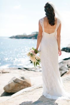 Classic beach wedding dress: Photography : Hello Love Photography Read More on SMP: http://www.stylemepretty.com/massachusetts-weddings/gloucester/2016/02/19/rustic-elegant-sharksmouth-estate-summer-wedding/