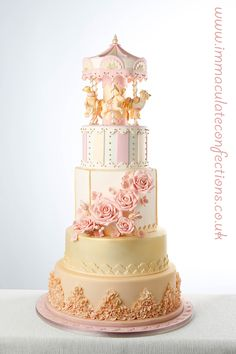http://www.immaculateconfections.co.uk/carousel-wedding-cake/