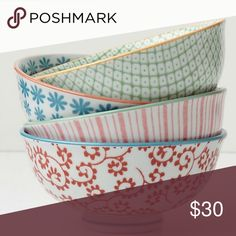 """Anthropologie - set of 7 small colorful bowls Beautiful porcelain bowls from Anthro. Perfect for entertaining , serving sides or deserts. It's the perfect size for a side or rice or as an ice cream bowl. Dimensions are 2.25"""" tall x 4.5"""" diameter. Microwave and dishwasher safe. I am also selling a matching set of larger serving bowls in a separate listing. Bundle to get a bigger discount! Thanks :) note: there are individual photos of each pattern in the listing. All available except blue…"""