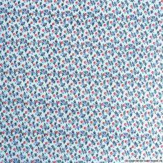 Tissu vendu en coupon de 3 mètres, coton imprimé bouquet de fleurs bleu et rouge. Très léger et souple, idéal pour réaliser robes, jupes, vêtements pour enfants etc.