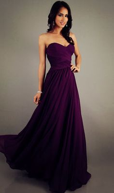 Bridesmaids dress idea in this shade of Purple and Black for my bridesmaids to wear but they need to be modest by having short sleeves.