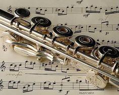 Flute resting on unidentified music. closeup of openhole keys