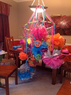 This is the ceiling center piece that I created with all the puff balls that we made plus, extra girlie frills added for fun!