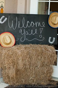 Hay bales, chalkboard sign saying Howdy Y'all, cowboy hats, and I'll add a saddle at the front door for party decorations.