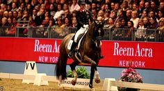 World record hat-trick for Charlotte Dujardin  Charlotte & Valegro scored an amazing 93.975% in the Freestyle to Music at Olympia Horse Show, beating the World Record with an incredible display! #supremeproducts #charlottedujardin #valegro #blueberry #olympiahorseshow #dressage #worldrecordholder