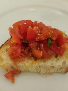 Bruschetta. Tomatoes, basil, garlic, extra virgin olive oil on grilled bread. Summer bliss!