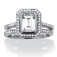 Embrace elegance with this lavish emerald-cut cubic zirconia ring highlighted by delicate cz accents. 1.76 carats T.W.Price - $49-vTg3NIJf