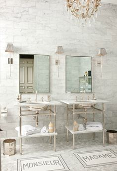 Mix and Chic: Dreamy bath~ love the marble wall, sconces, chandelier, and those fabulous mats in front of the vanities~ ADORE!