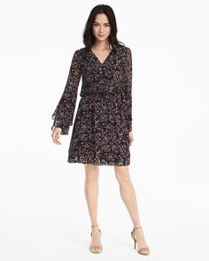 """The season's most romantic trends—bell sleeves and boho influence—are at arm's length with this flowy black dress. Double-layer hem and ditzy print adds to the romance. Wear loose or cinch with our double-bar denim belt.   Boho-inspired bell sleeve dress in black with scattered print Soft goldtone V-neck hardware detail Polyester. Machine wash cold; may be dry cleaned. Regular: Approx. 35 1/2"""" from shoulder; 2 1/2"""" above the knee Petite: Approx. 43"""" from shoulder Imported"""
