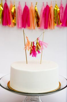 Tissue Tassel Cake Topper with Mylar How fun is this?