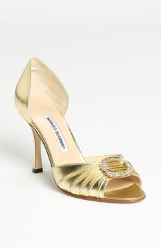Dreaming of these shiny gold Manolo Blahnik open toe d'Orsay pumps.