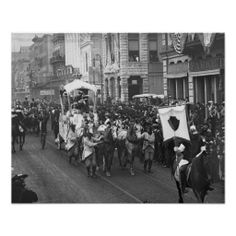 Rex, King of the Carnival passes along Camp Street during a Mardi Gras parade. New Orleans, circa 1906.