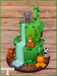 Safari themed cake for a 1st Birthday with a fondant zebra, elephant, lion, tiger and giraffe.  www.facebook.com/i.love.cuteology.cakes