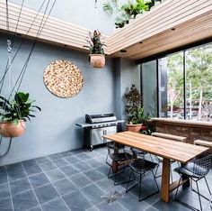 Outdoor terrace with wood features on The Block Glasshouse Exterior Design, Interior And Exterior, The Block Australia, The Block Glasshouse, Shipping Container House Plans, Terrace Design, Outdoor Living Areas, Glass House, Outdoor Entertaining