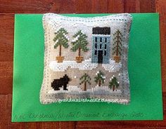 Snowy pines cross stitched ornament (it has a bear and pine trees--would make a nice gift for Paula!)