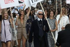 She took control of the megaphone (and the crowd) during Chanel's protest-themed spring '15 runway presentation.   - ELLE.com