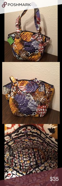 Vera Bradley Painted Feathers Glenna NWT The Glenna has front and back exterior pockets. The interior has a zippered and three slip in pockets. It has a recessed zippered closure. This comes from a smoke free and pet free home! Vera Bradley Bags Shoulder Bags
