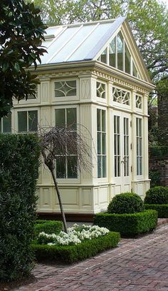 Beautiful conservatory with great details.  If only I had money and a gardener...I'd fill with roses, pansies, hydrangea, lilies, and a black marble pond stocked with water lilies and frogs.