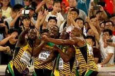 The best images from Beijing!  Nickel Ashmeade, Asafa Powell, Bolt and Nesta Carter celebrate their victory with a few selfies