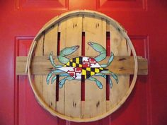 Blue or red crab with Maryland flag on shell. Hand painted on recycled crab bushel lid. by DettasDelight on Etsy https://www.etsy.com/listing/270174065/blue-or-red-crab-with-maryland-flag-on