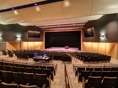 Liberty High School: The new theater was designed with a capacity, modified thrust/proscenium stage, and full orchetra pit to accommodate the active performing arts program. Auditorium Design, Liberty High School, Art Programs, Performing Arts, Entrance, Architecture, Theater, Table, Furniture