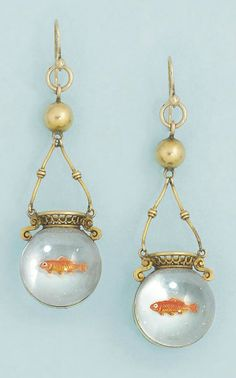 A pair of Victorian reverse painted crystal intaglio ear pendants. Each designed as a rock crystal spherical goldfish bowl with single painted goldfish, to gold twin bar and bead suspension and pierced basket work detail, circa 1870.