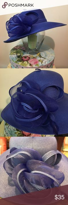 FLASH SALE! NWOT August Accessories Grecia Hat NWOT August Accessories Grecia Down Brim Hat. Color is Blue. Flower detail looks great worn in front or back. Never been worn. Great condition. August Hats Accessories Hats