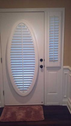 Pretty Front Door Swag Love How The Oval Window Frames It