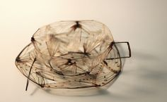 Carrianne Bullard made this tea set out of the wings and legs of cicadas.