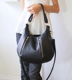 Black leather bag from Etsy.
