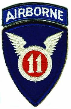 Nickname: The Angels. .......  Shoulder Patch:    White numeral 11 on red circle in white winged-circle against a royal blue shield, topped by airborne arc. ....... History:  Derived from  11th Inf. Division, organized Aug., 1918, Camp (Port) Meade.   Demob. Feb., 1919. ........ Training:  Reactivated: Feb. 25, 1943, Camp Mackall, N. C., under Airborne Command. Other station: Camp Polk, La. Maneuvers: La., 1944. Overseas: April 1944 (SWP