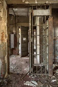 Prison-like bars at old Phoenix House reformatory and rehab center; Hart Island, NYC