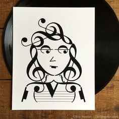 Everyone's in love with the It Girl! This pretty lady is created entirely with music notes and symbols. Archival quality fine art print is printed in deep black on bright white, acid-free, 100% cotton