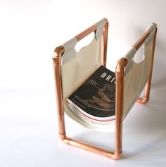 obsessed with this copper pipe magazine holder