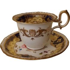 Here is a gorgeous H R Daniel tea cup and saucer in pattern circa It features the second gadroon shape, heavily gilded, with a cobalt ground and buff bands surrounding enameled flowers. Tea Cup Set, Tea Cup Saucer, English Tea Cups, Perfect Cup Of Tea, Antique Tea Cups, Coffee Cups And Saucers, Tea Tins, Tea Service, Vintage Tea