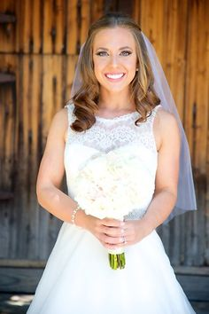 Center-parted, shoulder-length hair feels fresh and youthful paired with a classic lace gown.