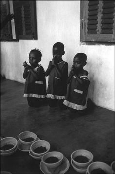 Nigerian orphans praying before a meal