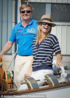 Enjoying themselves: The Dutch royals smiled and waved as they sailed along in the sunshine