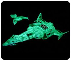 I built this model.  The little ship was stored in a bay in top of the bigger one.  Mine didn't glow quite like this!