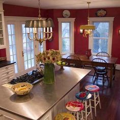 Love the stainless island top!  Rich, red walls and crisp, white trim are a dramatic backdrop for this TOH reader's Colonial kitchen remodel. Photo:  David Lasnick. thisoldhouse.com