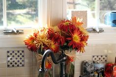 fresh flowers will add a touch of fall to your kitchen