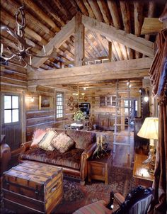 love this small cabin with a loft