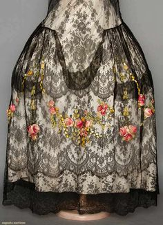 Robe de style, 1920s; Black Chantilly lace, skirt front and back with cascade of silk ribbon flowers