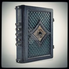 Black-green, fine, dark, Gothic leather journal... Beautifully embossed, hand toned, with metal decorations and silver finish. A handmade creation which pays homage to old book binding styles. Jour...