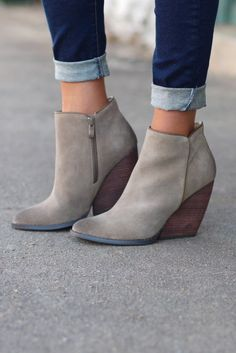 "Stylish wedge bootie, the Whitby, from Very Volatile has a super soft suede leather upper on a stacked heel. Almond toe. Khaki in color. Model is wearing size 8, which is her usual size. Suede leather upper with shapely almond toe Side zipper closure Rubber sole 3-1/2"" wedge heel"