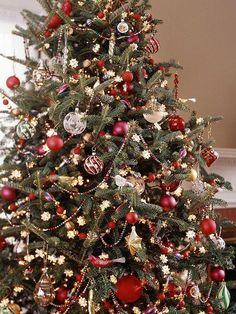 Repeat one type of ornament so it creates a color, shape, or theme through a tree. These red decorations help unite the other one-of-a-kind ornaments. We recommend buying two to four dozen of a main theme element (like these red balls). Various sizes, shapes, or finishes of such an element will add even more flair.