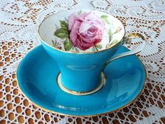 gorgeous blue and floral corset style cup and saucer