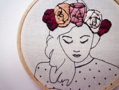 Macie is gorgeous!! She has a hand stitched floral crown over printed outlines. She looks lovely with her other floral crown friends (see image 4 for example). She comes ready to hang and would be a lovely gift for that quirky friend.
