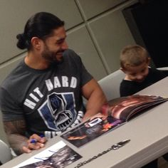 "look at him. making others happy is what makes him happy. say that ""he's being nice because he has to be"" all you want – that's a real genuine smile on that man's face. and on the kids too. he's nice because he's just a nice  person and he likes making others smile. God bless you Roman Reigns."